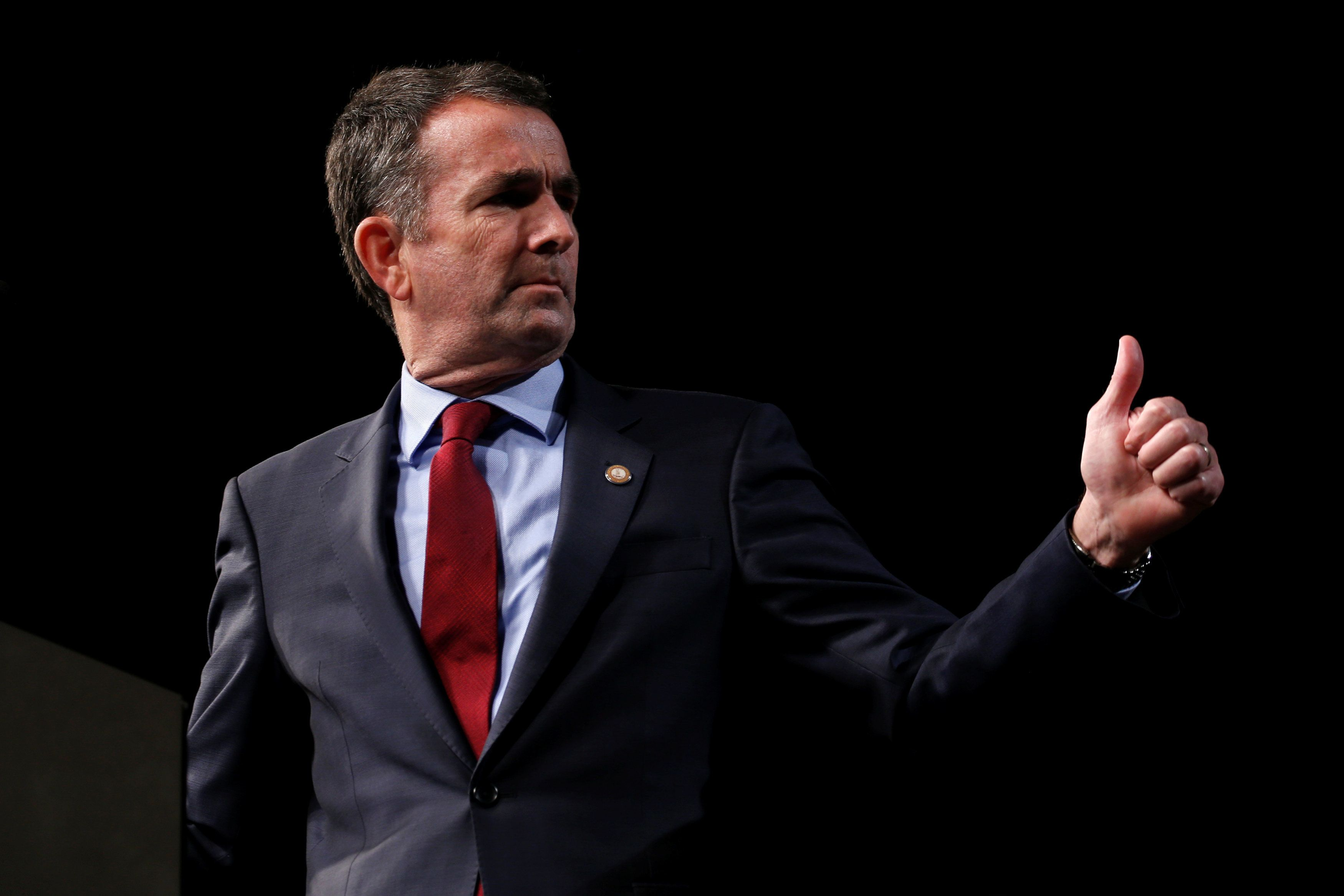 Virginia Lieutenant Governor Ralph Northam, Democratic candidate for governor, delivers remarks before introducing former U.S. President Barack Obama to speak at a rally with supporters in Richmond, Virginia, U.S. October 19, 2017.  REUTERS/Jonathan Ernst