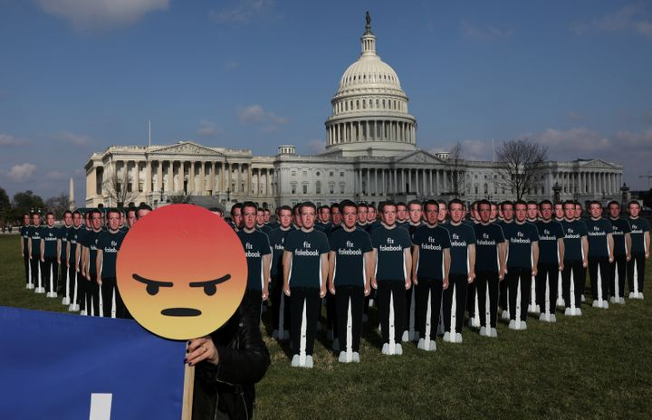 Dozens of cardboard cut-outs of Facebook CEO Mark Zuckerberg are placed outside of the U.S. Capitol Building as par