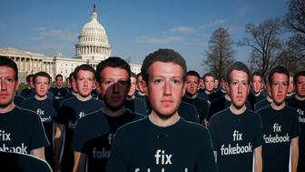 Dozens of cardboard cutouts of Facebook CEO Mark Zuckerberg are seen during an Avaaz.org protest outside the U.S. Capitol in Washington, U.S., April 10, 2018. REUTERS/Aaron P. Bernstein