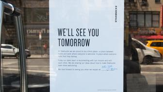 A sign in the window announces that  Starbucks closes for racial bias training in Chelsea on May 29, 2018, in New York. - Starbucks is closing more than 8,000 stores across the United States Tuesday to conduct employee training on racial bias, a closely watched exercise that spotlights lingering problems of discrimination nationwide. (Photo by Bryan R. Smith / AFP)        (Photo credit should read BRYAN R. SMITH/AFP/Getty Images)