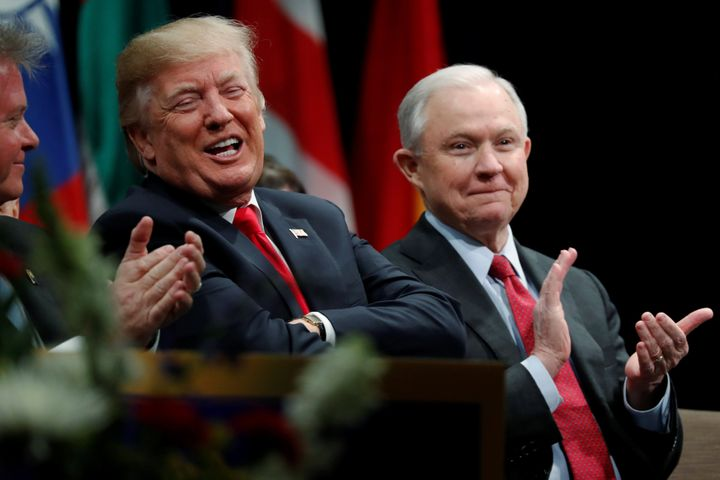 President Donald Trump with Attorney General Jeff Sessions at a graduation ceremony at the FBI Academy in Quantico, Virginia,