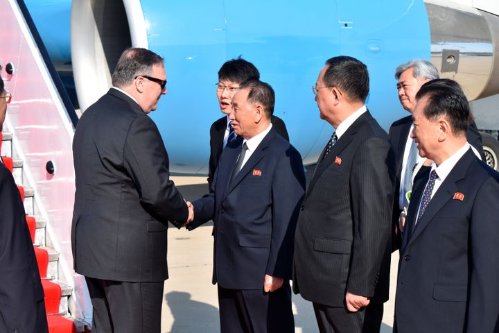 U.S. Secretary of State Mike Pompeo (left) is greeted by Kim Yong Chol in Pyongyang on May 9, 2018.