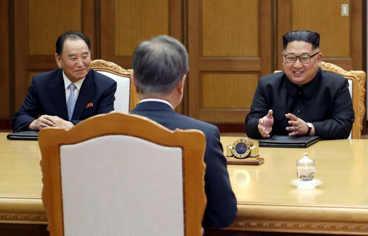 Kim Yong Chol (left) and Kim Jong Un speaking with South Korean President Moon Jae In at a meeting at the truce village