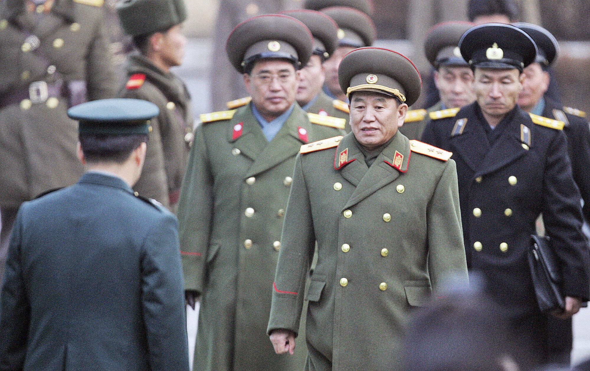 North Korean chief delegate Kim Yong Chol (2nd-R) and other military officers are greeted by South Korean officers after crossing the border line at the south side of the truce village of Panmunjom, in the demilitarized zone (DMZ), separating the two Koreas since 1950-53 Korean War, north of Seoul, 12 December 2007.    AFP PHOTO / POOL (Photo credit should read LEE JIN-MAN/AFP/Getty Images)