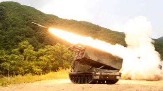 A rocket is launched from a M-270A1, multiple launch rocket system, during a combined rocket live fire training exercise of the 1-38th Field Artillery, 210th Fires Brigade of the U.S. 2nd Infantry Division and South Korean Army's artillery unit 2000 at Rocket Valley training area near the demilitarized zone separating the two Koreas, in Cheorwon, 77 km (48 miles) northeast of Seoul, June 12, 2012. The exercise was conducted to increase readiness to defend South Korea according to the U.S. 2nd Infantry Division.  REUTERS/Lee Jae-Won (SOUTH KOREA - Tags: MILITARY)