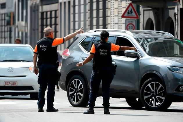 Police officers redirect traffic in the eastern Belgian city of