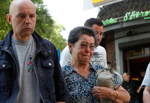 Bernadette Hennart, mother of late police officer Soraya Belkacemi, accompanied by her son Kamel Belkacemi...