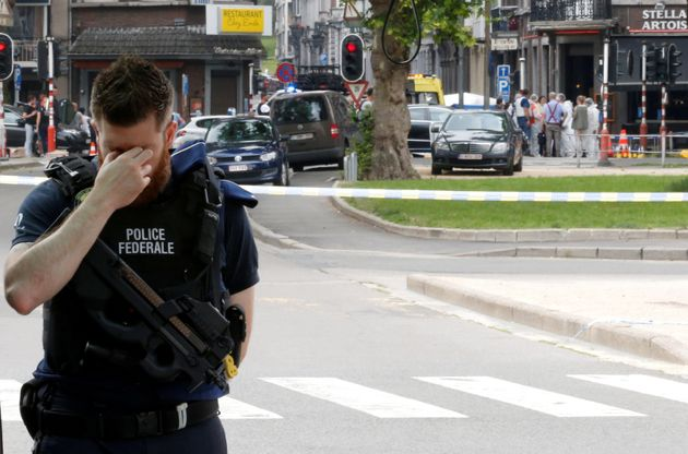 A police officer is seen on the scene of a shooting in Liege,