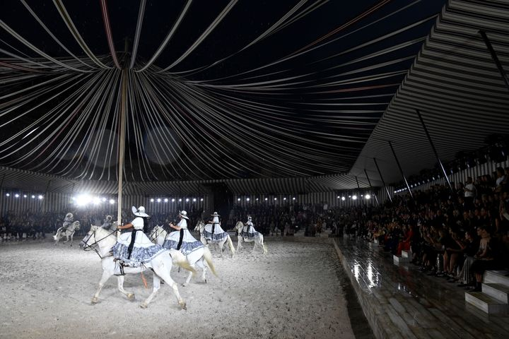 Riders on horseback perform during the Dior cruise fashion show in France last week.