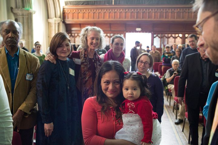 Aura Hernandez, an undocumented immigrant from Guatemala, and her daughter, are introduced to the congregation of the Fourth