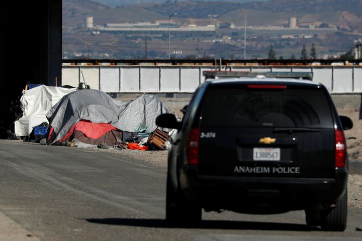 Police conduct a patrol as part of a campaign to clear a large homeless encampment in Anaheim, California on Jan. 22, 20