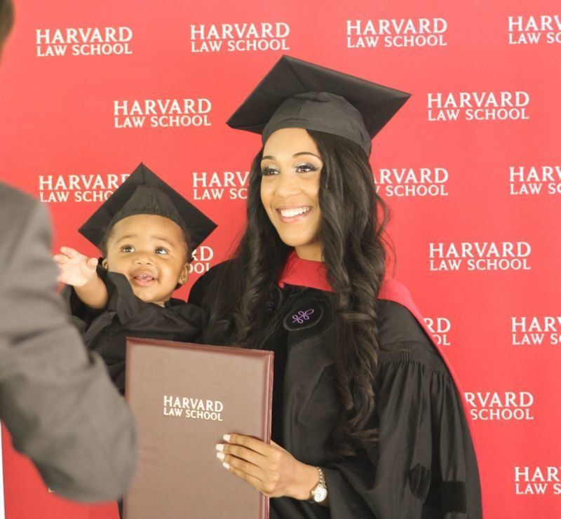 Briana Williams graduates from Harvard Law School, accompanied by her daughter, Evelyn.