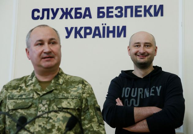 Russian journalist Arkady Babchenko, right, who was reported murdered in the Ukrainian capital, and head...