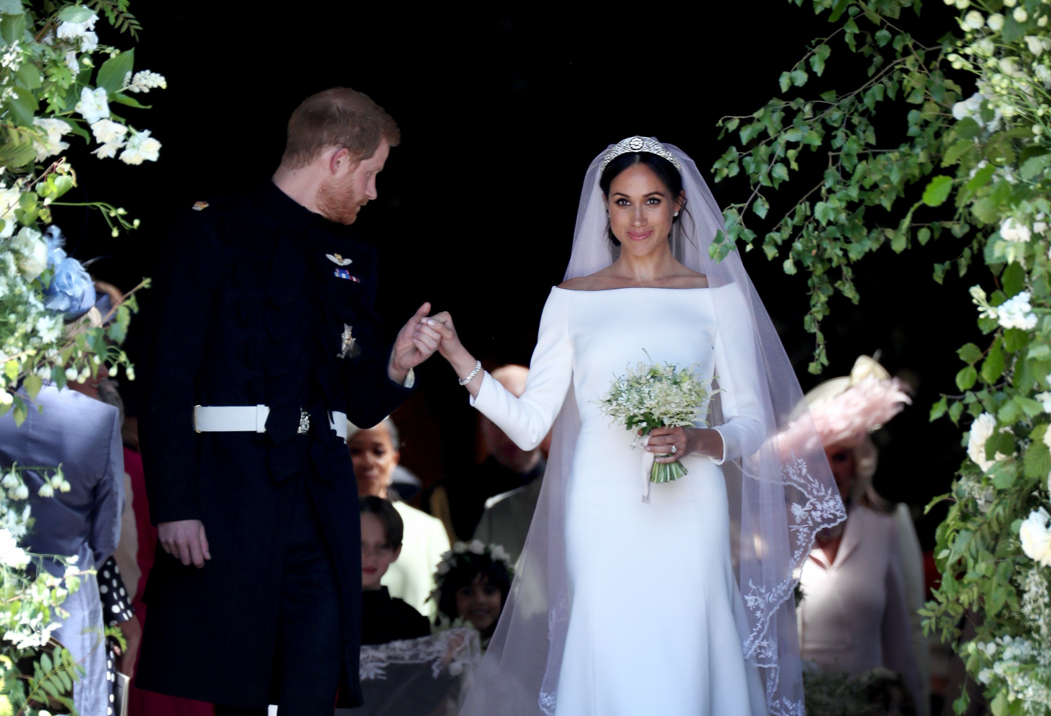 The Duke and Duchess of Sussex on their big day. Embroiderers working on the veil washed their hands every half-hour to keep it spotless before the ceremony.