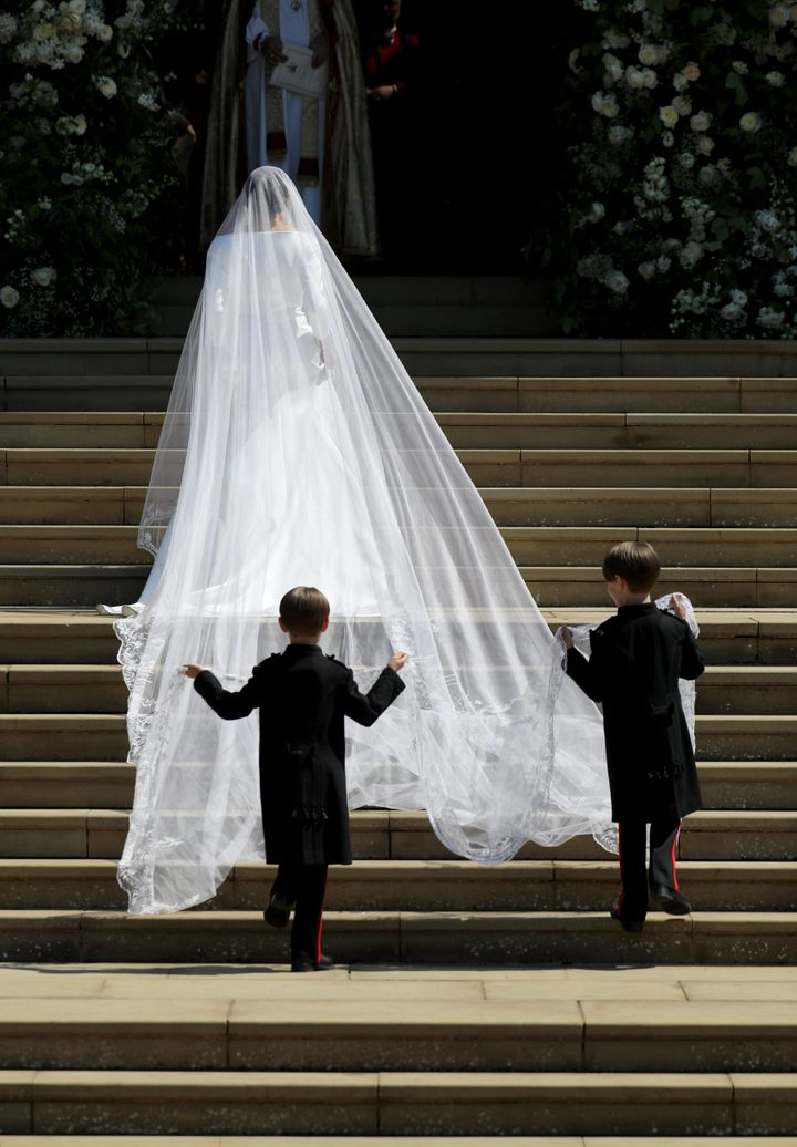 Pageboys John and Brian Mulroneyfollow Markle into the chapel,carrying her gorgeous 16-foot veil.