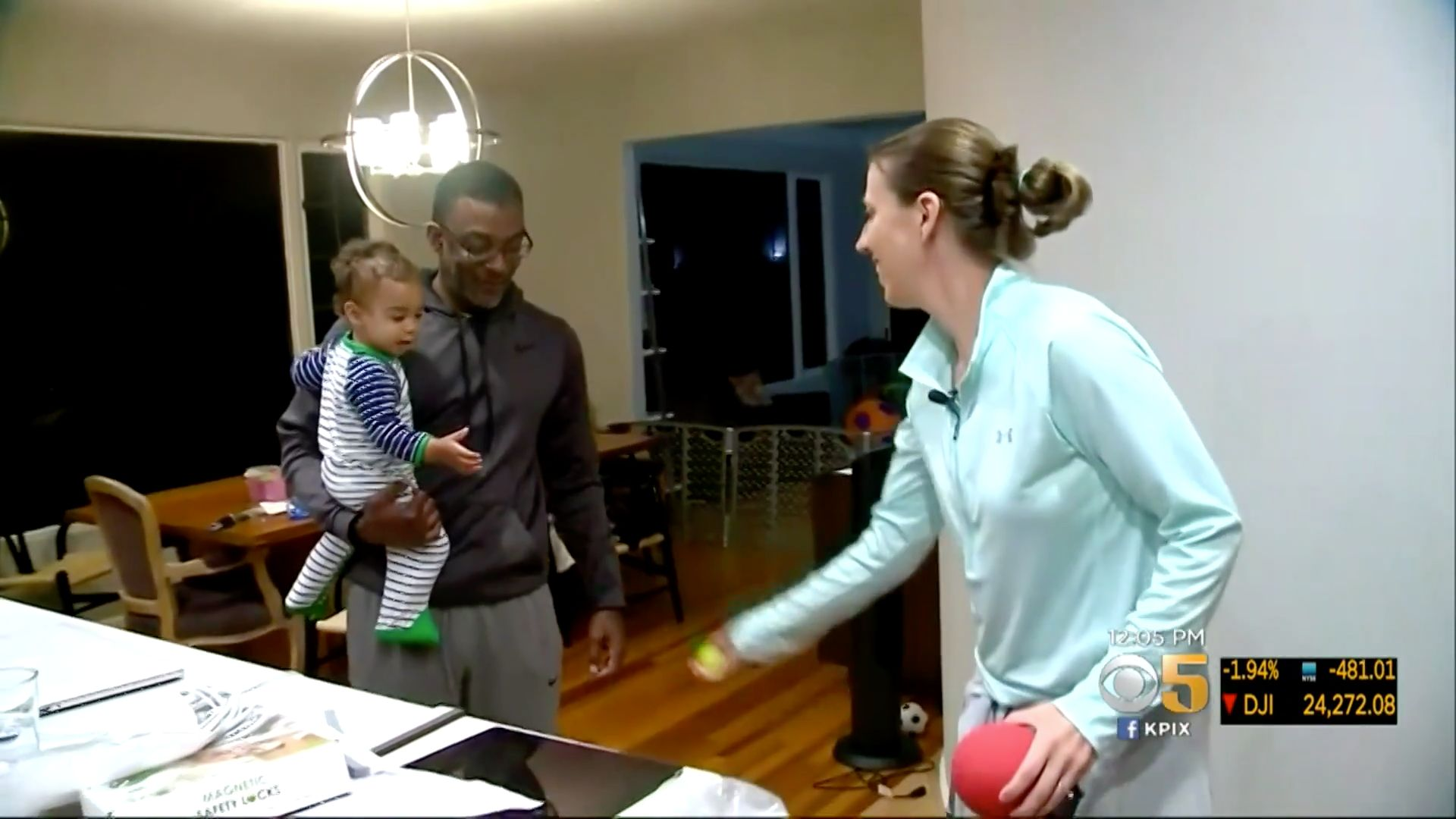 Lindsay Gottlieb is seen playing with her 1-year-old son who is biracial