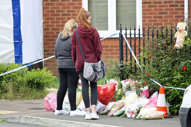 People pay their respects in Dexter Way, Gloucester where the bodies of 31-year-old Laura Mortimer and her 11-year-old daughter Ella Dalby were found on Bank Holiday Monday.