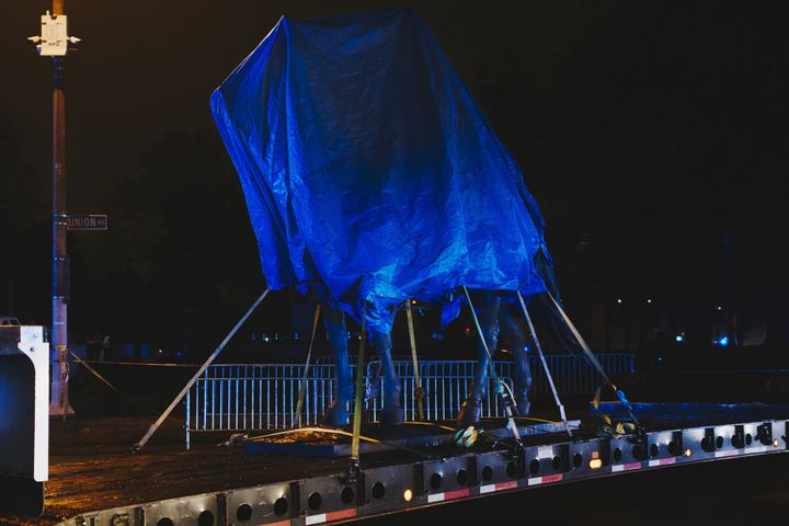 The statue of Gen. Nathan Bedford Forrest sits under a tarp on a truck after being removed from a Memphis park on Dec. 20, 20
