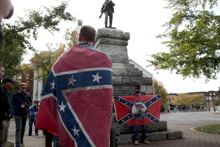 "Confederate flags are displayed at a ""White Lives Matter"" rally on Oct. 28 in Murfreesboro, Tennessee."