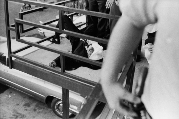 The partially covered body of slain American civil rights leader Martin Luther King Jr. on the balcony of a Memphis motel aft