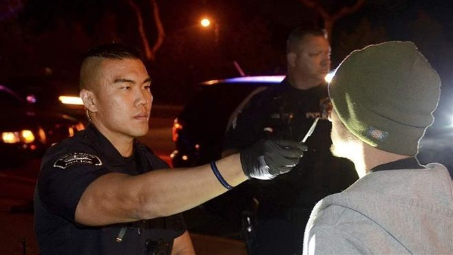 Fullerton, California, police officer Jae Song conducts a field sobriety test on a driver suspected of driving while impaired