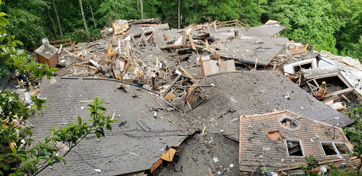 A home is seen destroyed in Boone North Carolina on Wednesday after mudslides and flash floods wrecked havoc in the area