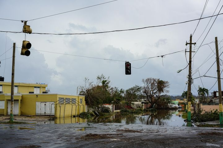 An intersection is flooded with water from a nearby lake after Hurricane Maria at Lagos de Plata in Levittown, Puerto Rico on