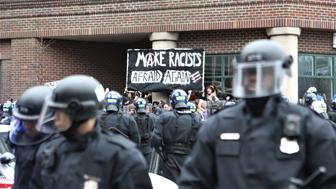 (170120) -- Washington, D.C., January 20, 2017 --Protesters are surrounded by riot police during a protest at the American Health Care Association in Washington, D.C. on January 20, 2017.   (Photo by Emily Molli/NurPhoto via Getty Images)