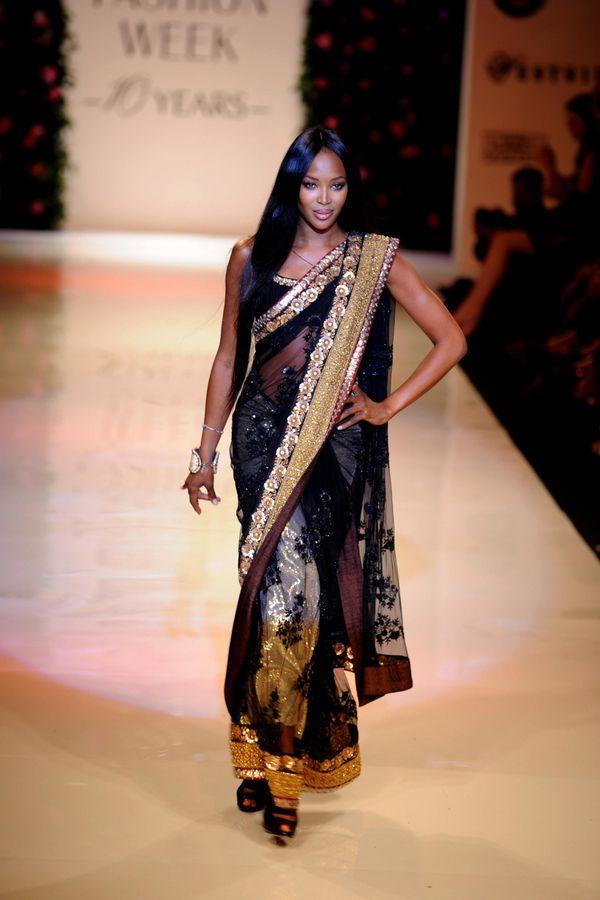 Walking the runwayfor My Mumbai, a charity show at the Lakme Fashion Week in Mumbai, India.