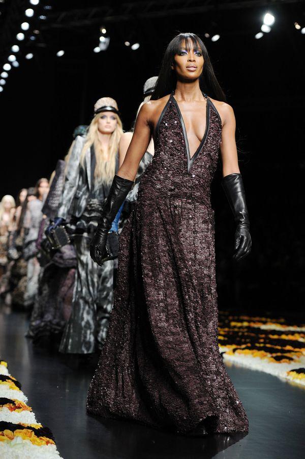 Walking the runway at the Roberto Cavallifall/winter show as part of Milan Womenswear Fashion Week.