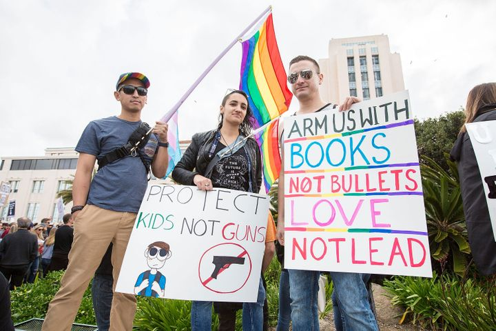 Alex Villafuerte, Jen LaBarbera and Fernando Lopez of San Diego Pride attend the March for Our Lives on March 24 in San Diego