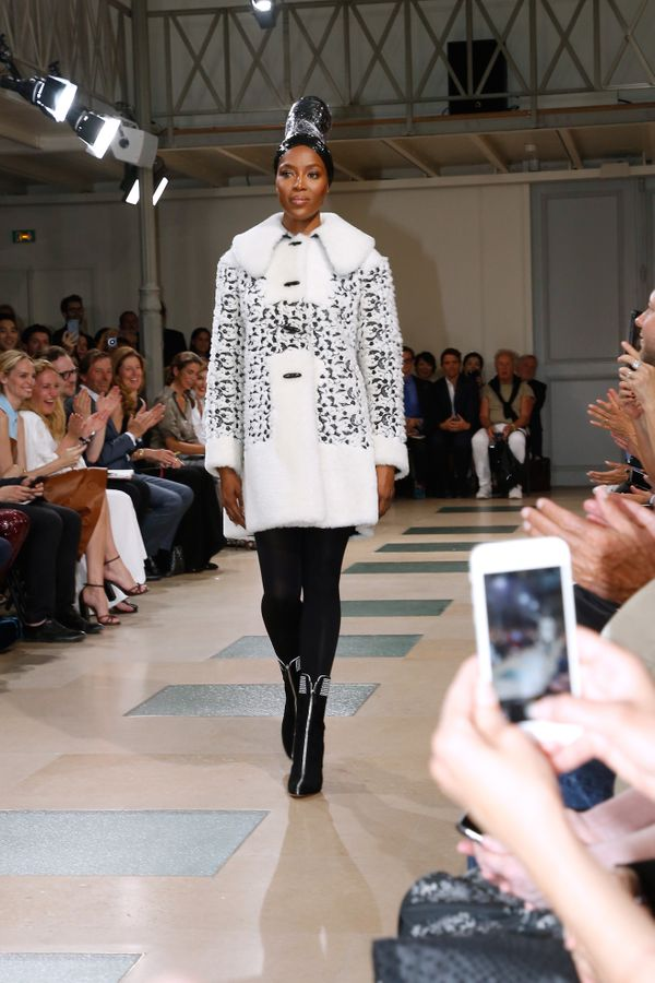 Walking at the end of the Azzedine Alaia show as part of Haute Couture Paris Fashion Week.