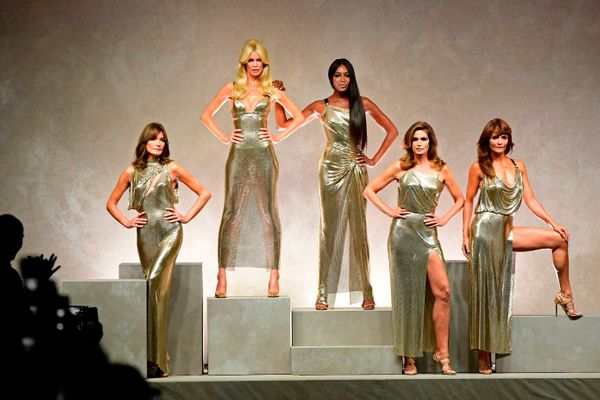Pictured with (from left) Carla Bruni, Claudia Schiffer, Cindy Crawford and Helena Christensen at the end of the show for Ver