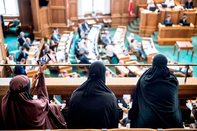 Women wearing niqabs sit in the gallery at the Danish Parliament in Copenhagen on