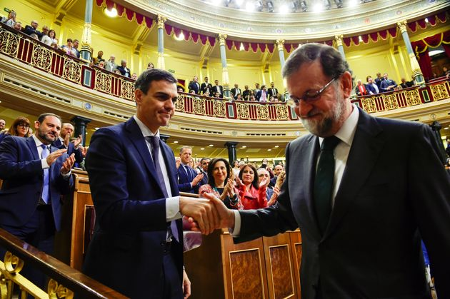 Spain's new Prime Minister and Socialist party (PSOE) leader Pedro Sanchez shakes hands with ousted Prime...