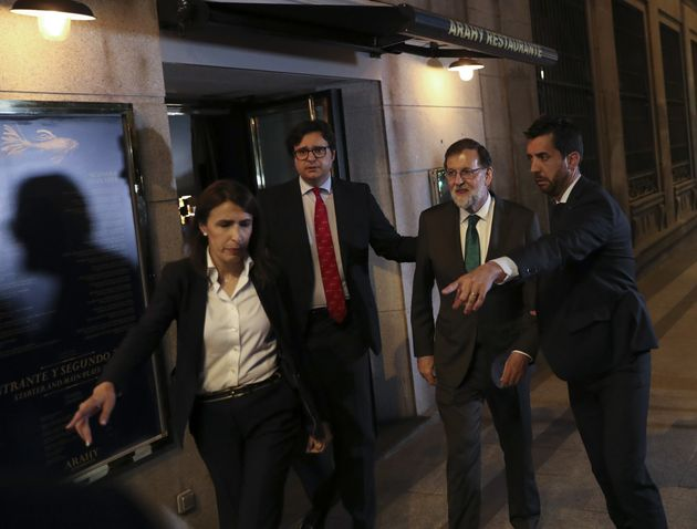 Spain's former Prime Minister Mariano Rajoy is led to his car just after 10pm local time after spendingmore...