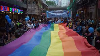 A giant rainbow flag is displayed during Hong Kong's annual pride parade on November 25, 2017. Rainbow flags flowed through the streets of Hong Kong on November 25 during the city's annual pride parade, as LGBT activists criticised authorities for lagging behind on equal rights. / AFP PHOTO / Aaron TAM        (Photo credit should read AARON TAM/AFP/Getty Images)