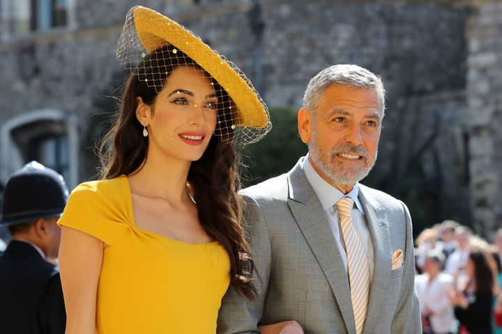 Amal Clooney, at the royal wedding with her actor husband, George, was recognized for her work as a human rights lawyer.