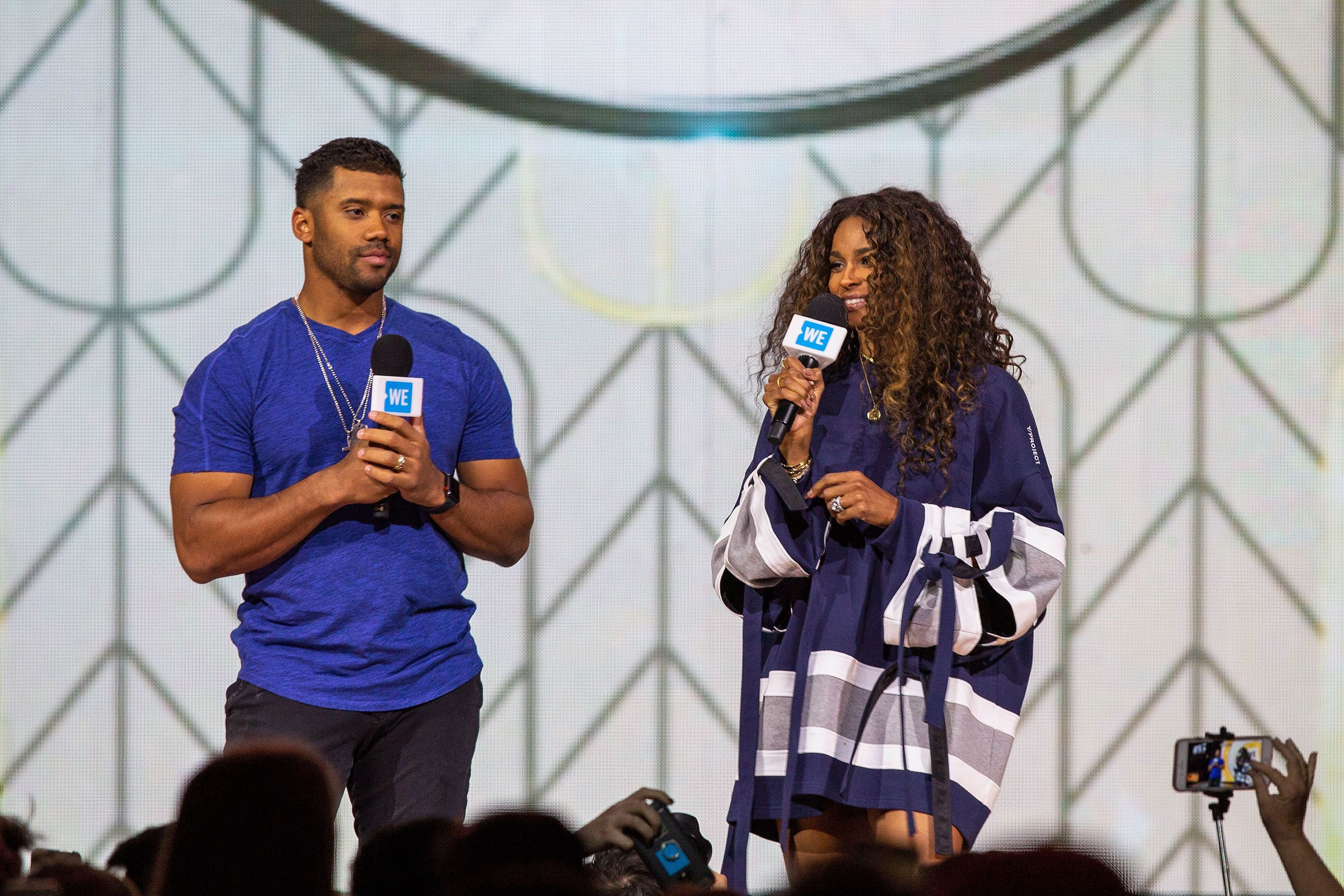 SEATTLE, WA - MAY 03:  Seattle Seahawks quarterback Russell Wilson and singer Ciara speak at WE Day at Key Arena on May 3, 2018 in Seattle, Washington.  (Photo by Suzi Pratt/WireImage)