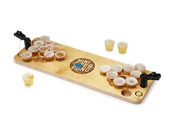 "Because dads can have fun, too. Get it <a href=""https://www.uncommongoods.com/product/mini-beer-pong"" target=""_blank"">here</a"