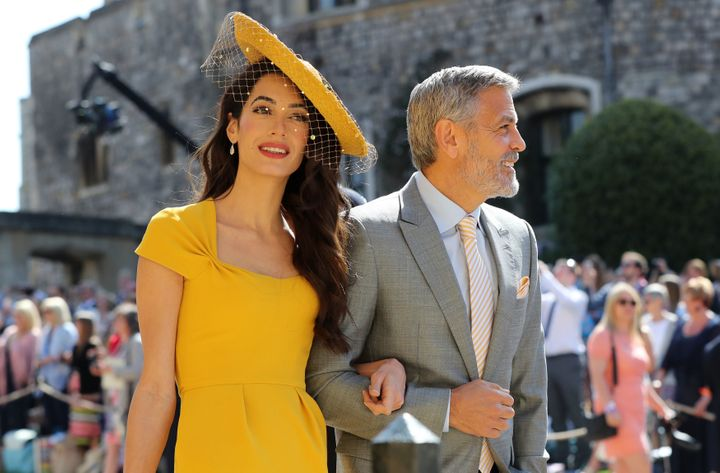 Amal Clooney and George Clooney arrive at St. George's Chapel at Windsor Castle before the royal wedding last month.