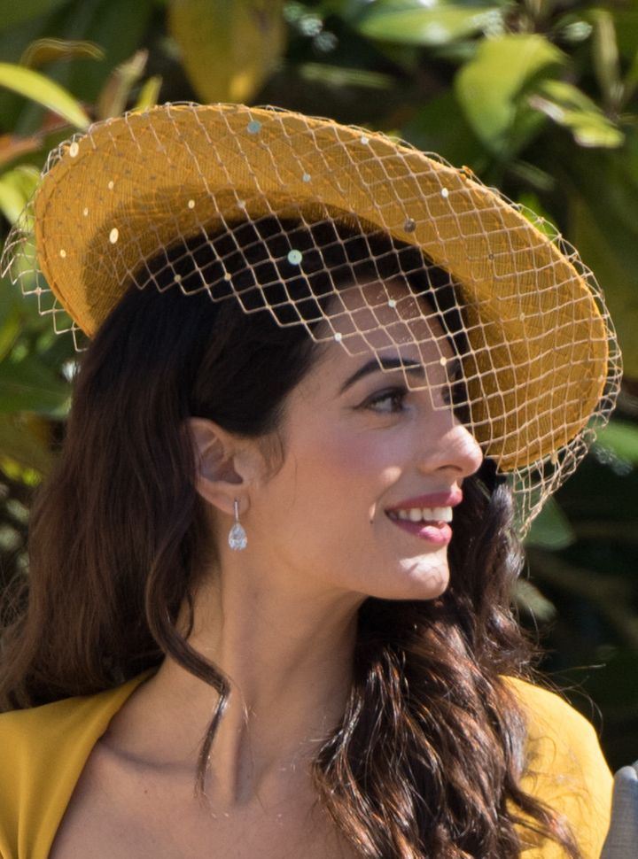 Clooney wore 17-carat teardrop earrings at the royal wedding.