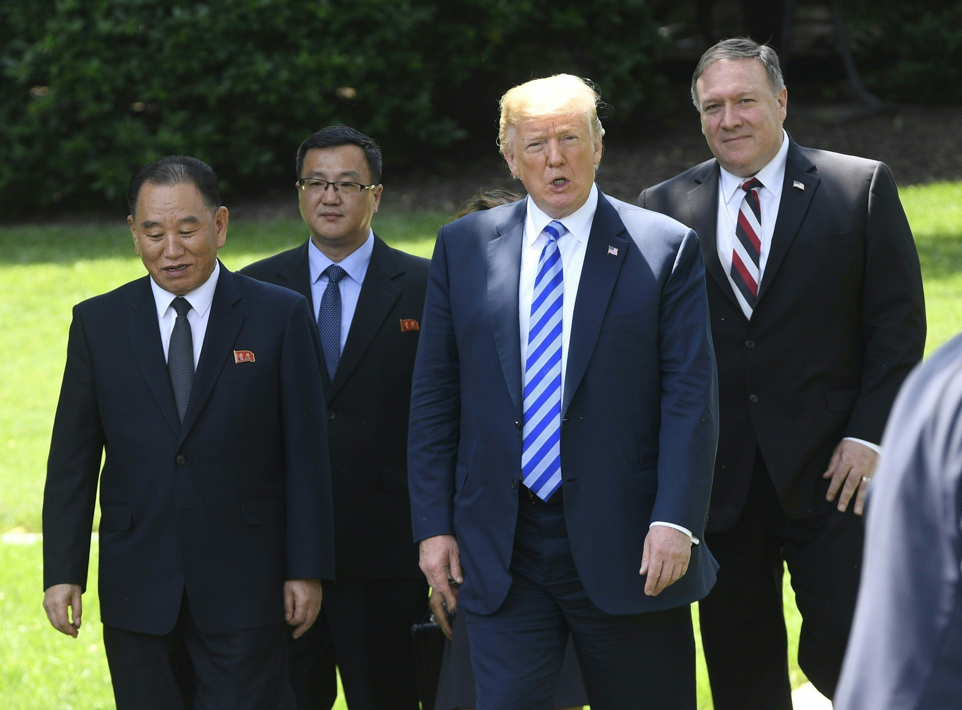 Trump flanked by US Secretary of State Mike Pompeo (R), walks with North Korean Kim Yong Chol (L) at the White House earlier today.
