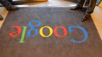 A Google carpet is seen at the entrance of the new headquarters of Google France before its official inauguration in Paris, France December 6, 2011. This logo has been updated and is no longer in use.  REUTERS/Jacques Brinon/Pool/File Photo