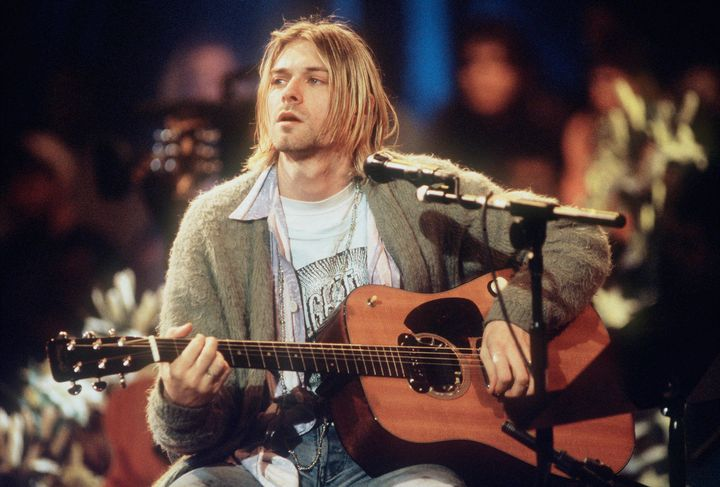 Kurt Cobain playing his 1959 Martin D-18E guitar, which is thought to be worth millions of dollars, during Nirvana's &l