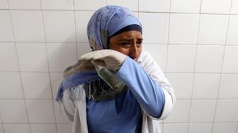 A colleague of Palestinian nurse Razan Al-Najar, who was killed during a protest at the Israel-Gaza border, reacts at a hospital in the southern Gaza Strip June 1, 2018. REUTERS/Ibraheem Abu Mustafa