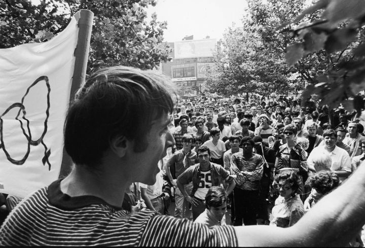 One month after the demonstrations and conflict at the Stonewall Inn, activist Marty Robinson speaks to a crowd of approximat