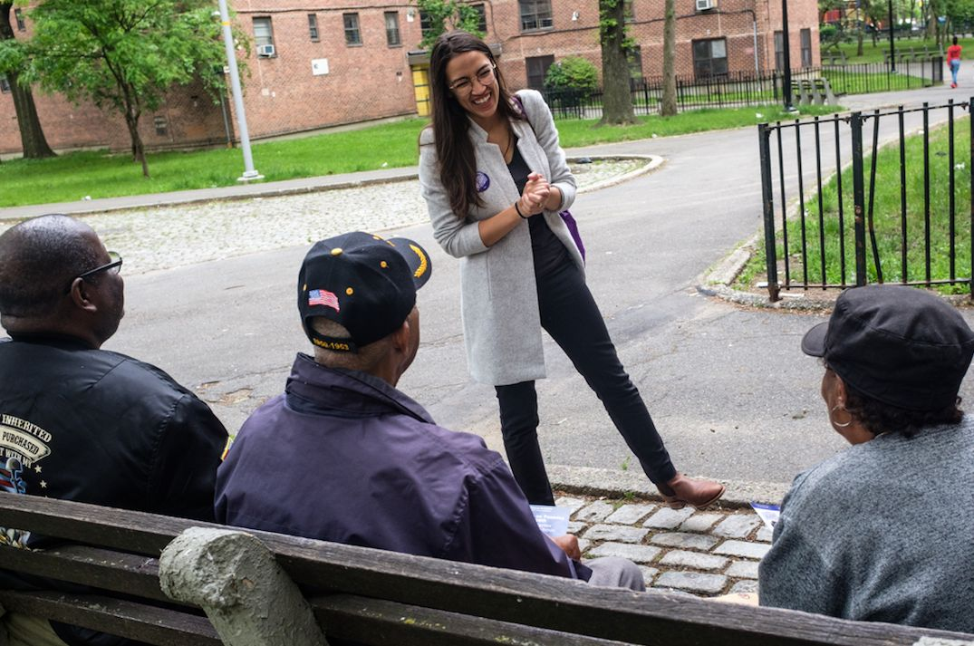 Alexandria Ocasio-Cortez canvasses in a Bronx, New York, neighborhood.