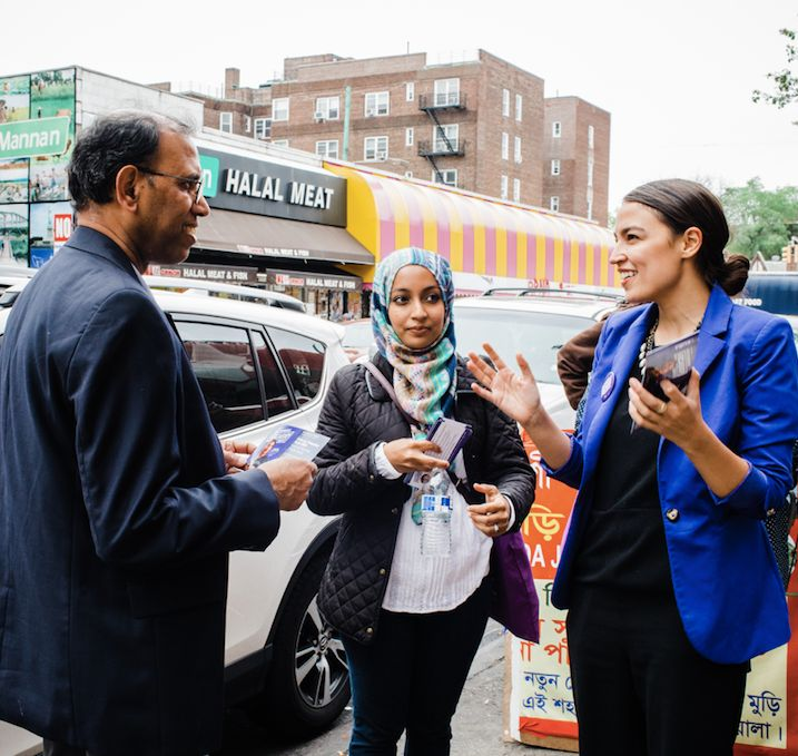 Alexandria Ocasio-Cortez talks with potential voters in the Queens borough of New York City.
