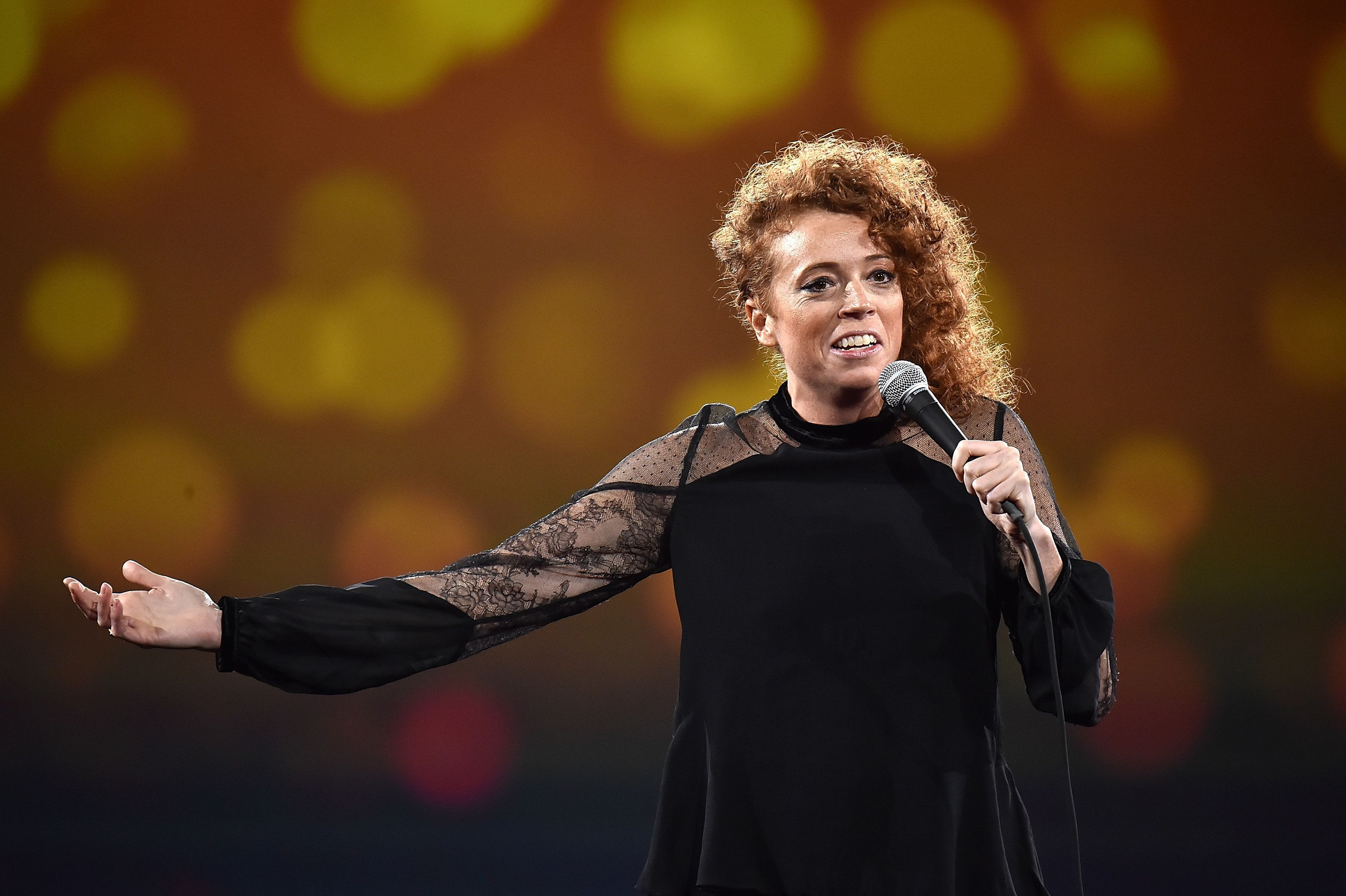 NEW YORK, NY - MAY 14:  Michelle Wolf performs on stage during The Robin Hood Foundation's 2018 benefit at Jacob Javitz Center on May 14, 2018 in New York City.  (Photo by Kevin Mazur/Getty Images for Robin Hood)